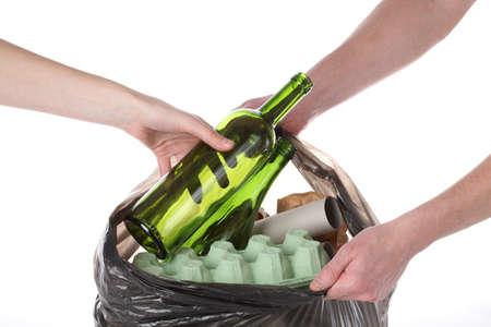 garbage dump: Putting rubbish into plastic bag with garbage