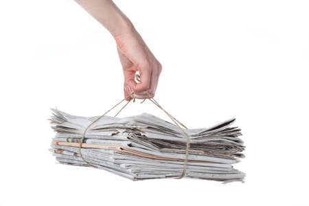 Bundle of newspaper tied with string ready for recycling photo