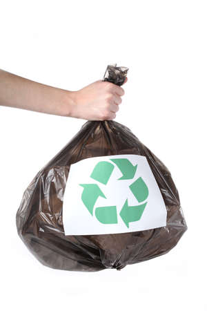 Plastic bag in human hand ready for recycling photo