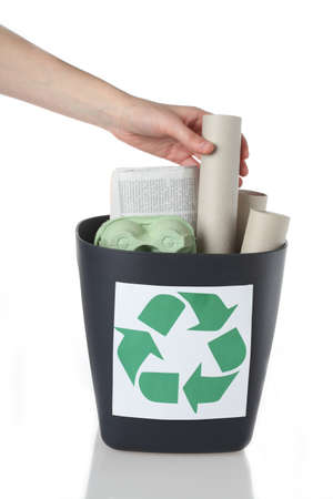 Paper rubbish putting into recycle bin, isolated Stock Photo - 16302965