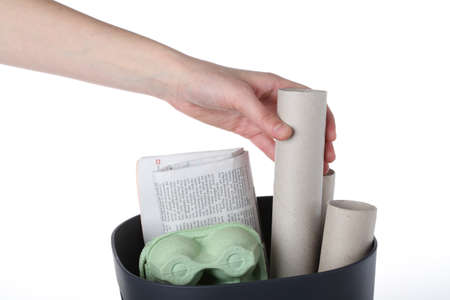 Hand putting paper garbage for recycle, isolated Stock Photo - 16302966