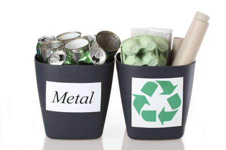 discarded metal: Two recyclable bins: metal tins and paper Stock Photo