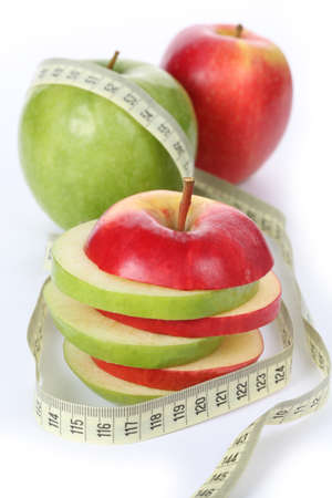Sliced apples with measure: dietary dessert, isolated photo