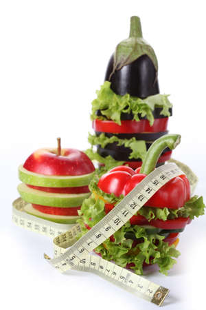 fitness goal: Sliced veggies with measure on isolated background