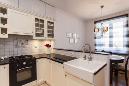 sink: New stylish kitchen with small dining room
