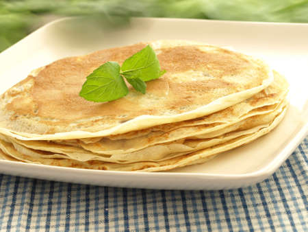 crepes: Sweet pancake breakfast served on the white plate