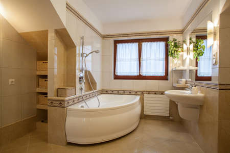 Bathroom in beige and creamy colors, modern house photo