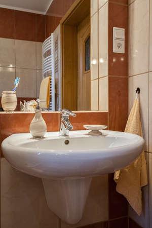 washbasin: White and ceramic washbasin in a bathroom
