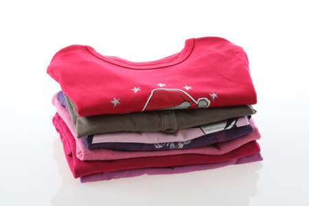 domestic task: Girls colorful t-shirts on isolated white background