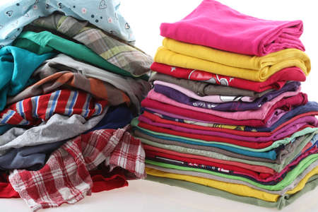 domestic task: Heap of clothes with ironed shirts, isolated background