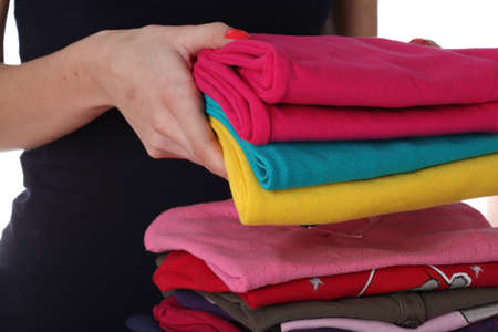Females hands laying down colorful clothes photo