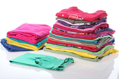 domestic task: Arranged clothes on studio isolated background