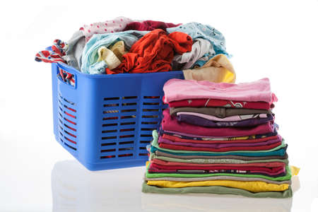 Basket of dirty and heap of clean clothes Stock Photo - 16685370