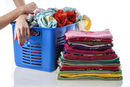 Pile of dirty and washed clothes on isolated background photo