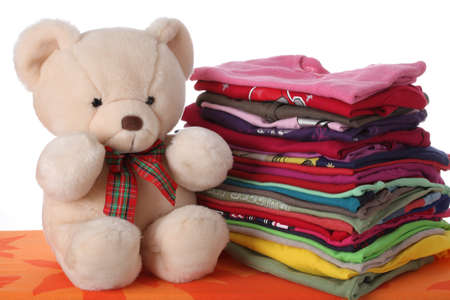 dry cleaners: Colorful childrens clothes with a teddy bear