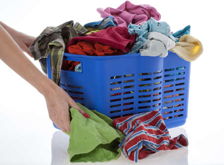 Woman collects lots of laundry, isolated Stock Photo - 16685367