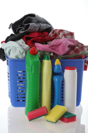 Mixed, dirty clothes in basket with chems Stock Photo - 16682011