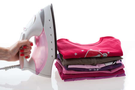 domestic task: Iron and arranged children clothes