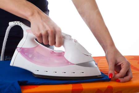 Woman ironing clothes on  isolated background photo