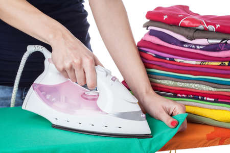 Ironing colorful clothes on ironing board photo