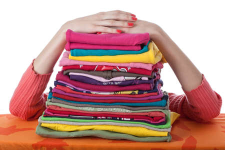 Heap of arranged colorful clothes, isolated photo