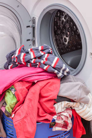 Open washing machine and pile of clothes Stock Photo - 16756042