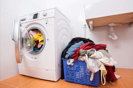 machine: Big heap of dirty clotches ready to washing Stock Photo