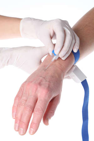 Closeup of putting needle with intravenous cannula on isolated background Stock Photo - 16827800