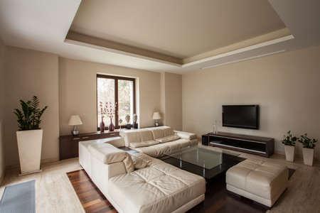 travertine house: Travertino casa Horizontal Vista del interior de una sala de estar