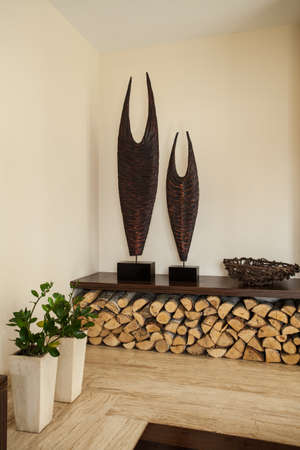 travertine house: Travertine house  Flowers, firewood in living room