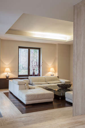 travertine house: Travertine house  Comfortable sofa in modern interior