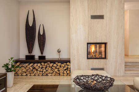 fireplace living room: Travertine house  interior of comfortable contemporary living room Stock Photo