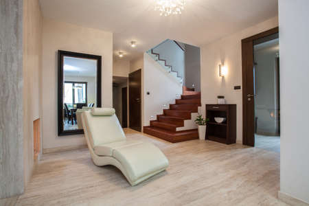 travertine house: Travertine house  hallway with comfortable armchair