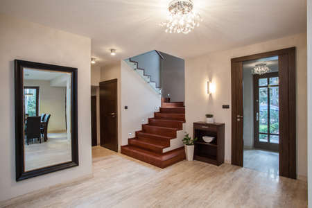 travertine house: Travertine house: entrance and hallway, modern interior Stock Photo