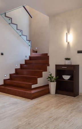 travertine house: Travertine house: wooden steps and glass barrier Stock Photo