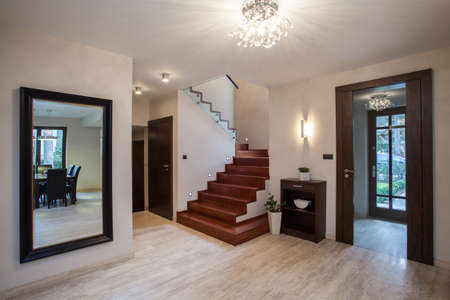 chandeliers: Travertine house: interior with hallway, stairs and entrance