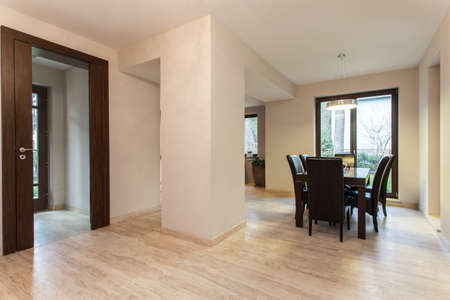 Travertine house: hallway and a dining room photo