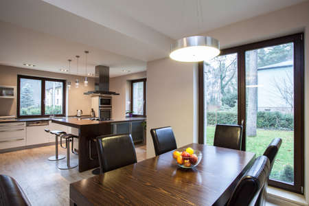 Travertine house - view of a dining room and kitchen photo