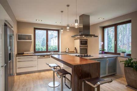 Travertine house - view of a bright, modern kitchen Stock Photo - 16841885