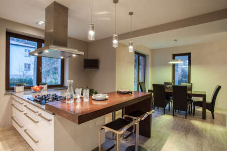 kitchen cabinets: Travertine house - view on  kitchen and dining room