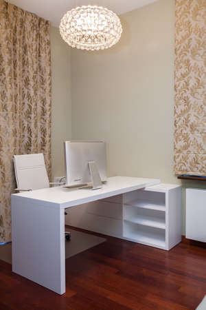 office cabinet: Travertine house - golden home office with white furniture Stock Photo