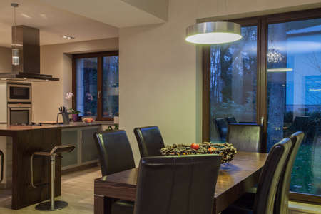 Travertine house - dinning room and view of kitchen photo