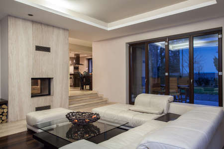 modern living room: Travertine house - living room and view of dining room