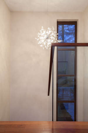 Travertine house - hallway with glass staircase. photo