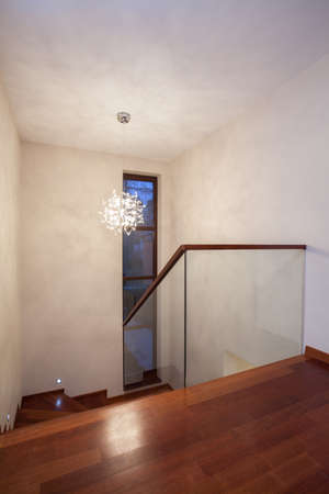 Travertine house - vertical view of the stairs photo