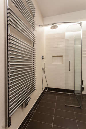 Travertine house - contemporary radiator in stylish bathroom photo