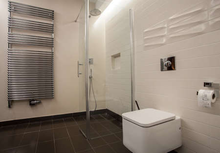 Travertine house - bathroom with a modern radiator photo