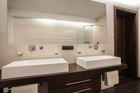 Travertine house - rectangular sinks in a modern bathroom photo