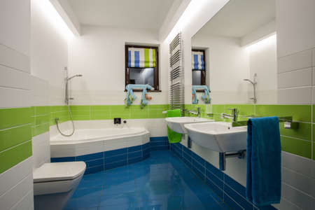 Travertine house - colorful childrens bathroom in modern style photo