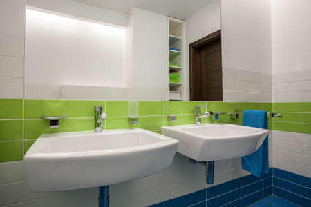 Travertine house - contemporary, colorful bathroom for two children photo